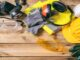 Work,Safety.,Construction,Site,Protective,Equipment,On,Wooden,Background,,Flat